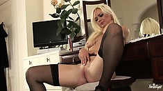 Foxy blonde in hot lingerie gets it off so she can reach her pink hole