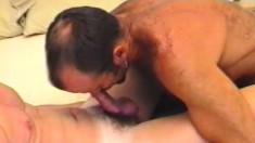 A pair of horny dudes enjoy some erotic sucking and fucking together